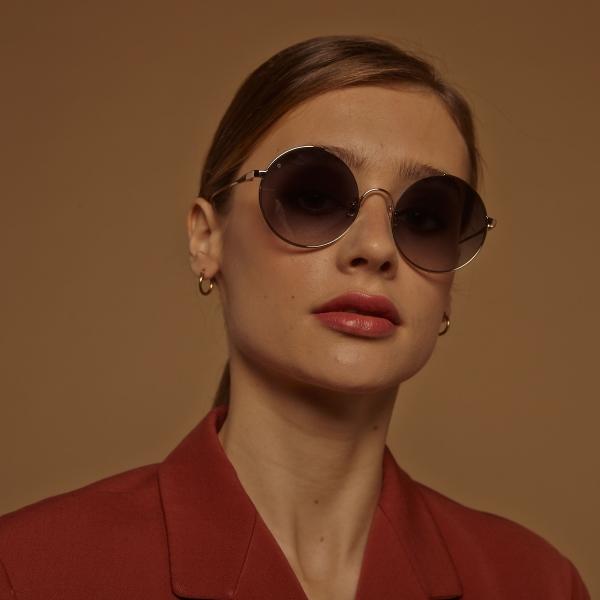 gigi-barcelona-6320-bali-gold-round-sunglasses-girl